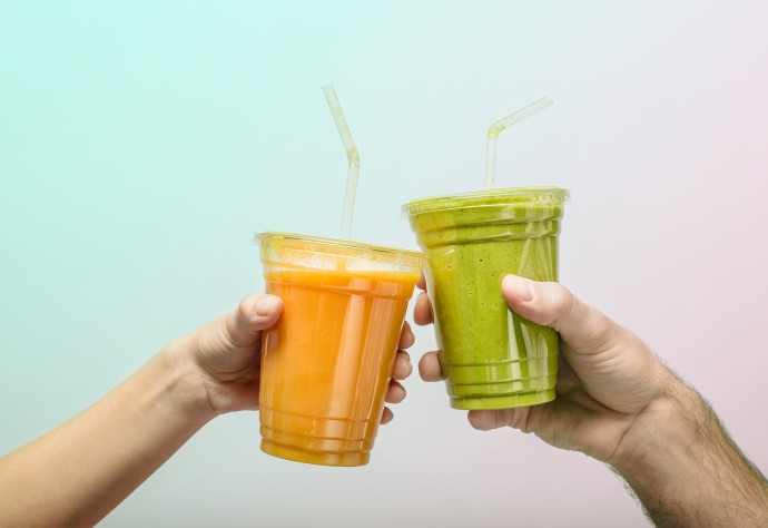 Two smoothies touching in air