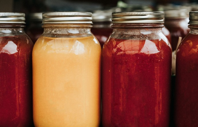 Cranberry and orange juices in mason jars