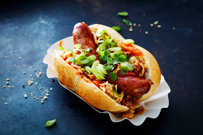 Hot dog in bun with toppings