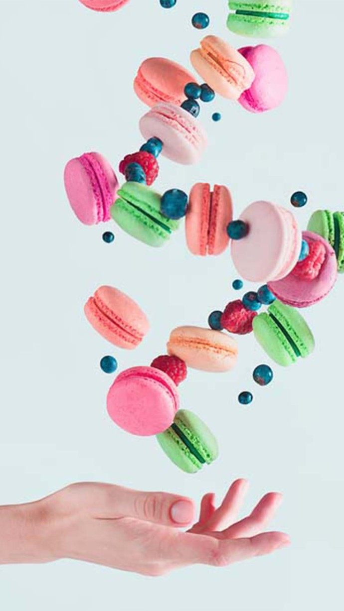 Colorful macarons thrown in air